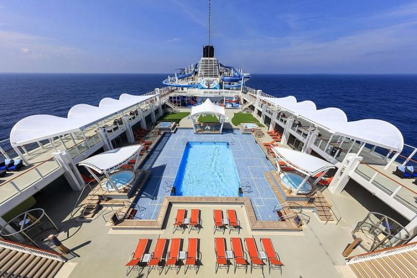 """Genting Cruise Lines, whose World Dream cruise ship is pictured here, has a total of 23 """"cruise to nowhere"""" sailings scheduled for next month and December."""