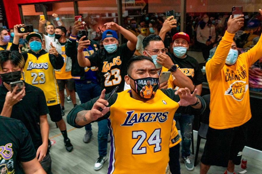 A fan sporting Bryant's No. 24 shirt is jubilant as he takes in Game 6 near the Lakers' Staples Centre home with fans not permitted at the NBA's Disney World bubble in Orlando.