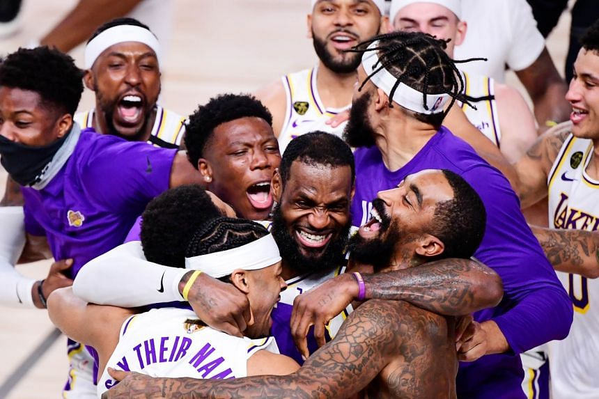 LeBron James (centre) celebrating with his LA Lakers teammates after winning their 17th NBA Championship with a 106-93 Game 6 victory over the Miami Heat.