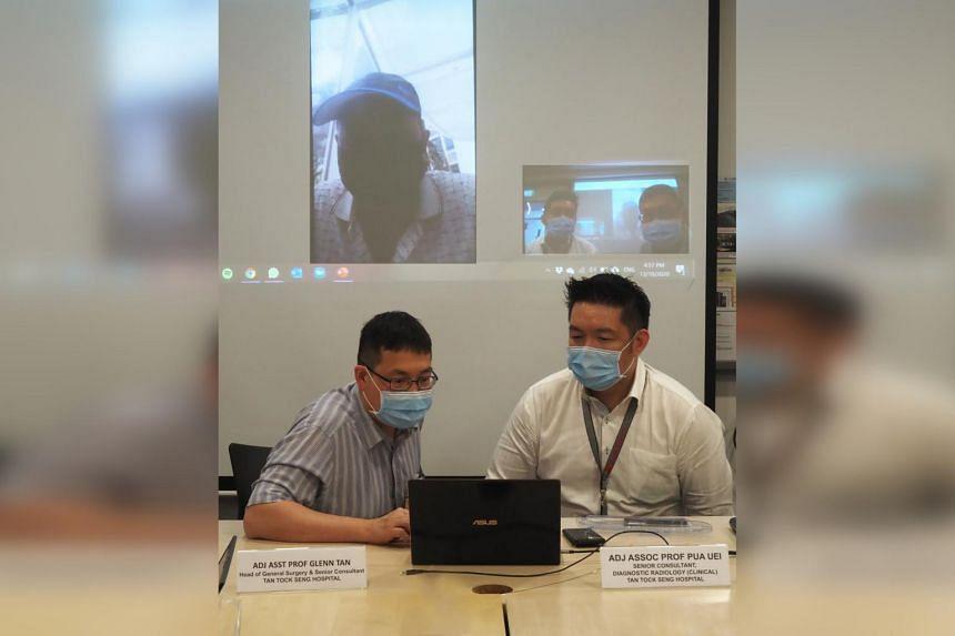 Adjunct Assistant Professor Glenn Tan (left) and Adjunct Associate Professor Pua Uei on a video call with Mr Ullah Kefayet.