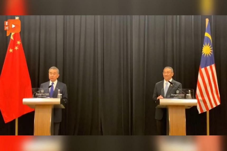 China's State Councillor Wang Yi and Malaysia's Foreign Minister Hishammuddin Hussein during a joint press conference on Oct 13, 2020.