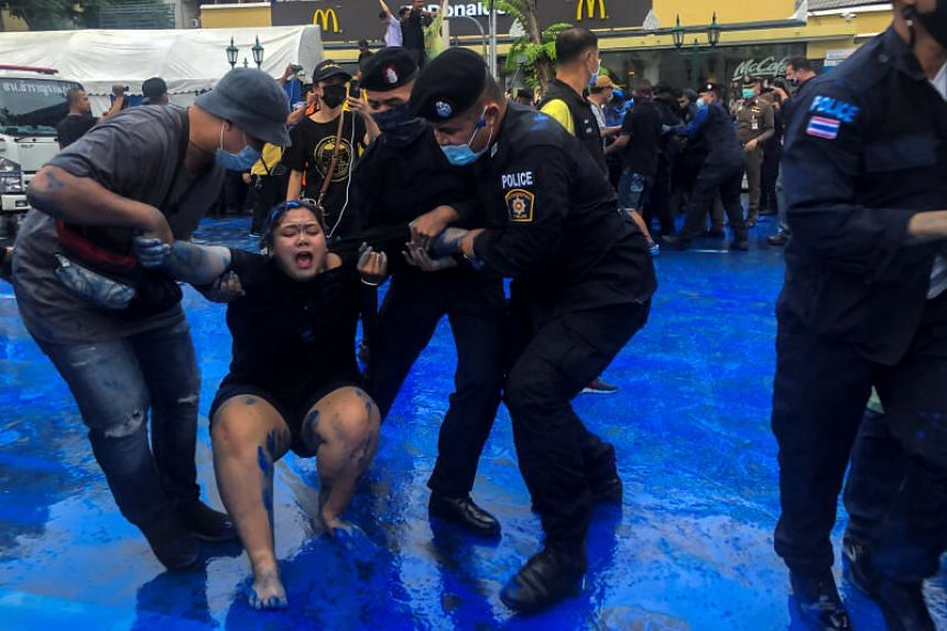 Thai police officers detaining a pro-democracy activist during a protest in Bangkok on Oct 13, 2020.