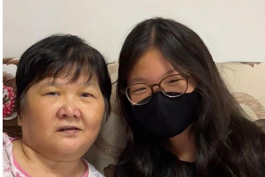 Sophia Chiam (right) with e-scooter accident victim Madam Ang Liu Kiow.