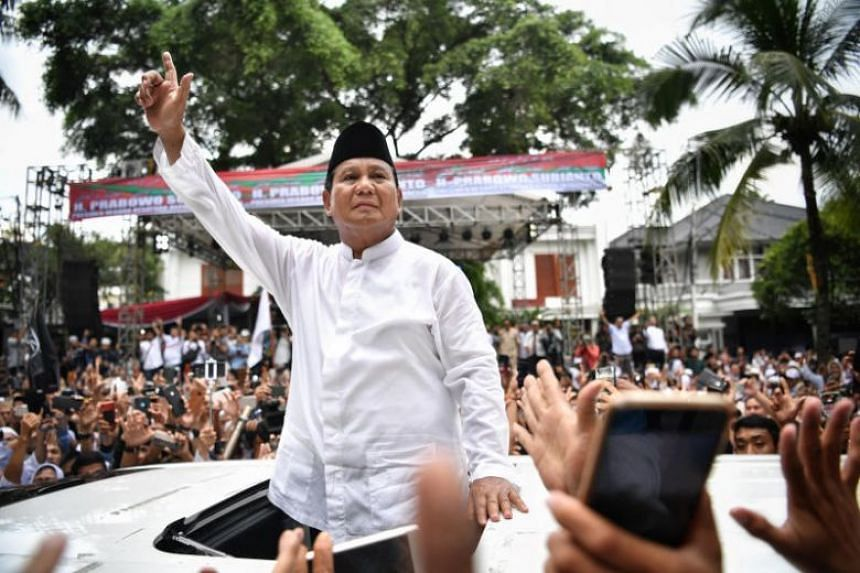 Indonesian Defence Minister Prabowo Subianto meeting his supporters outside his home in Jakarta, on April 19, 2019.