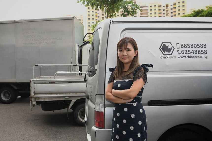 Ms Jeanne Kung, a shareholder of commercial vehicle rental and leasing firm Rhino Rental, with the three vehicles out of the firm's fleet of 77 that have not been rented out. She said distancing rules due to Covid-19 have driven up demand from tran