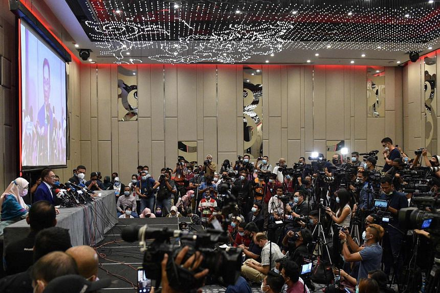 """Opposition leader Anwar Ibrahim and his wife Wan Azizah Wan Ismail at a news conference in Kuala Lumpur yesterday following his meeting with the Malaysian King. Mr Anwar said that it would be """"appropriate"""" for Prime Minister Muhyiddin Yassin to s"""