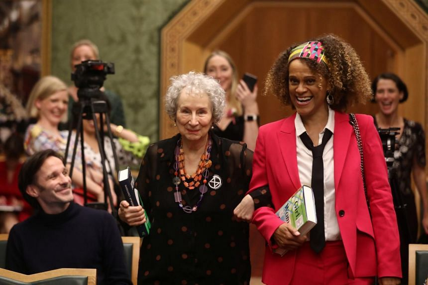 Atwood (left) wrote dystopian novel The Handmaid's Tale and its Booker Prize-winning sequel The Testaments.