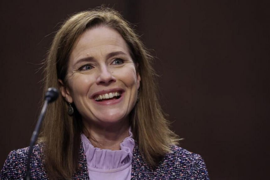 """Amy Coney Barrett said Supreme Court rulings have the """"force of law"""" but the court lacks enforcement power."""