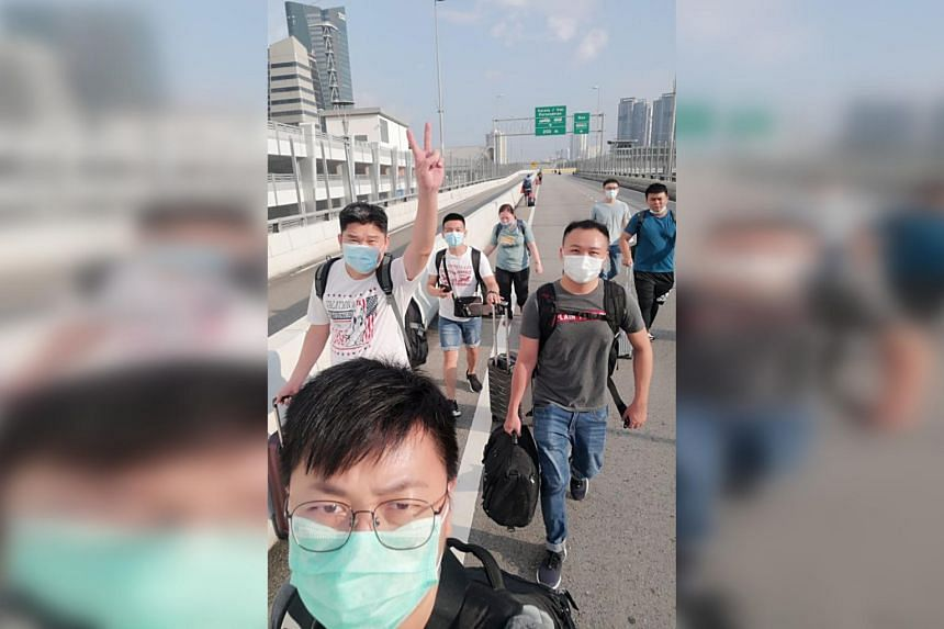 Staff of electronics giant Gain City crossing the Causeway to Singapore for work in August. Rents and leasings for Housing Board flats and condominium units rose last month as Malaysians returned to their jobs here.