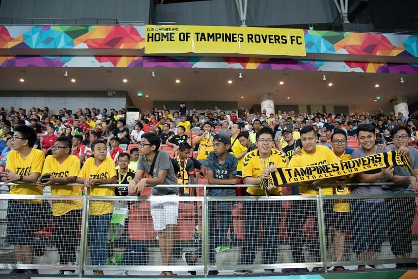 Tampines Rovers fan Pang Jia Tai (fifth from right) at a match at a packed Our Tampines Hub last year.