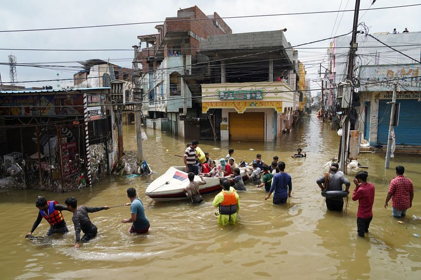 Residents are evacuated from a flooded neighbourhood in Hyderabad, India, on Oct 15, 2020.