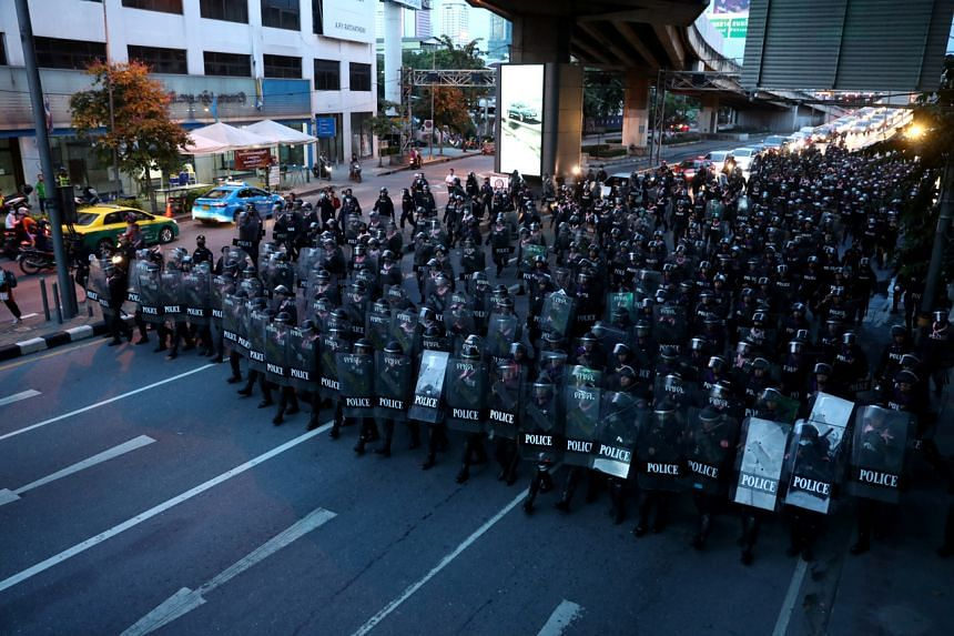 Riot police take up positions after a clash with anti-government protesters in Bangkok on Oct 15, 2020.