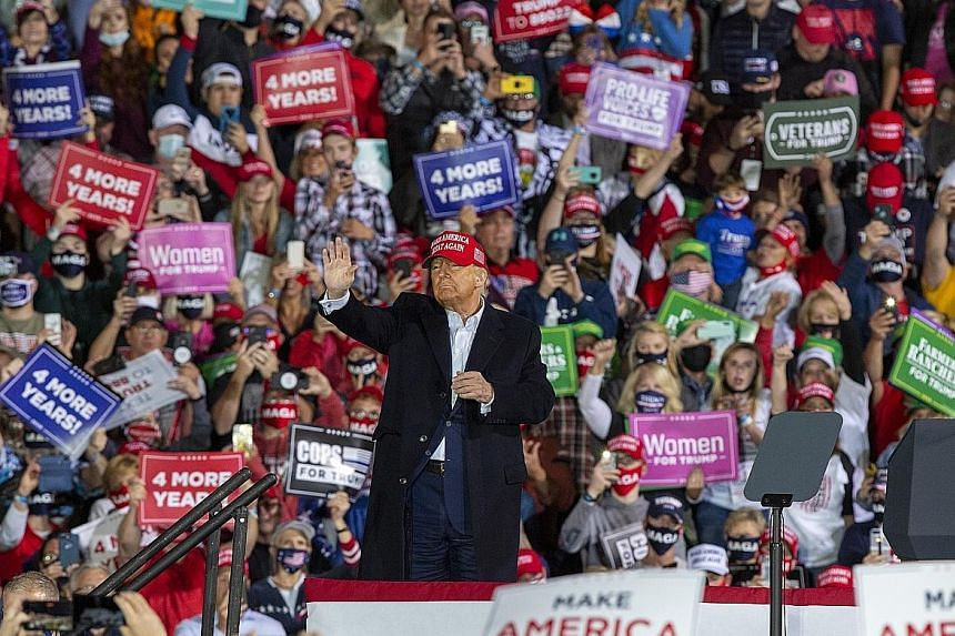 President Donald Trump campaigning in Des Moines, Iowa, on Wednesday. With 18 days before the election, early voting has started in two dozen states. In-person and mail-in voting are surpassing records amid concerns about Covid-19 transmission at pol