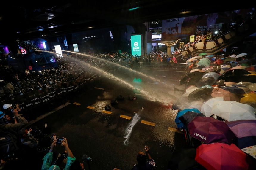 Thai riot police using water cannon against pro-democracy protesters in Bangkok on Oct 16, 2020.