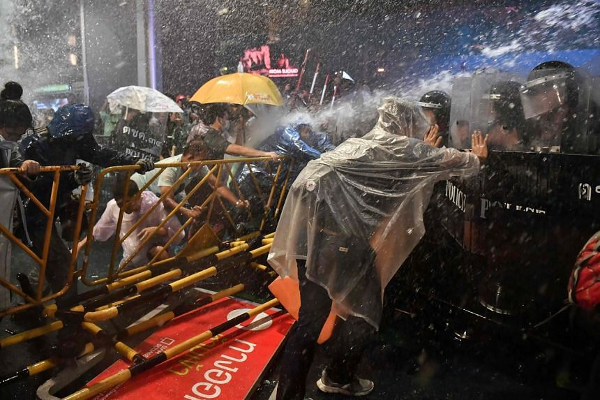 Thai police firing water cannon at pro-democracy protesters in Bangkok on Oct 16, 2020.