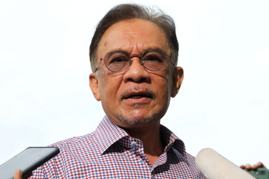 "Malaysia's opposition chief Anwar Ibrahim claimed he was called to police HQ due to ""political pressure""."