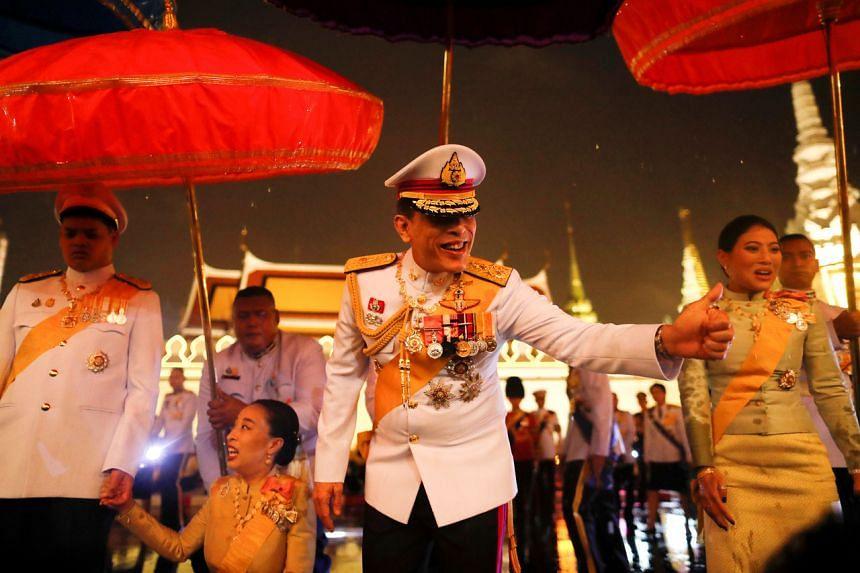 Thai King Maha Vajiralongkorn greet royalist supporters outside the Grand Palace in Bangkok, on Oct 13, 2020.