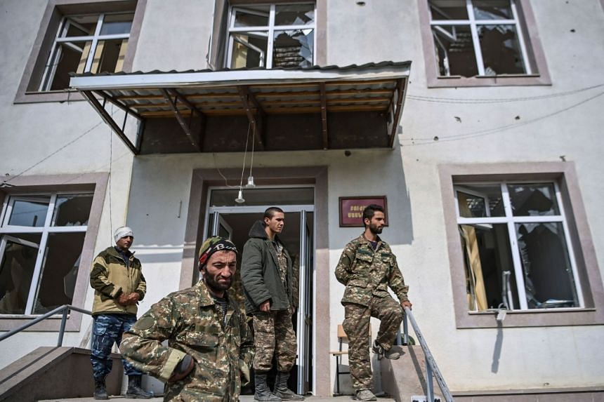 Armenian soldiers stand at a military hospital of the Martakert region on Oct 15, 2020.