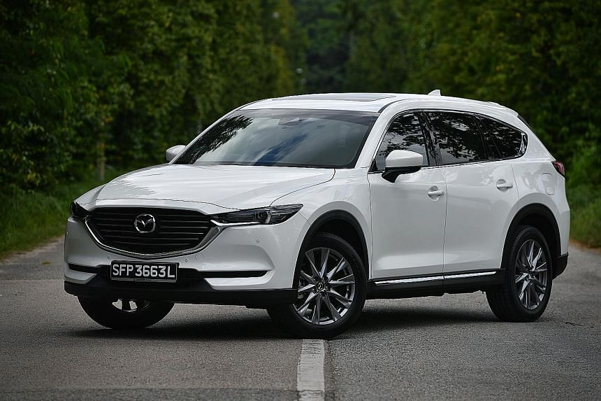 The Mazda CX-8 is well equipped, with premium features such as self-locking doors, adaptive LED headlights, lane-keeping assist, 360-degree camera, braking intervention, head-up display and attention alert.