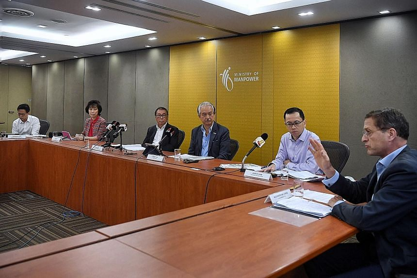 National Wages Council chairman Peter Seah (third from left) with (from left) NTUC assistant secretary-general Desmond Choo; NTUC president Mary Liew; Singapore National Employers Federation president Robert Yap; Permanent Secretary for Manpower Aube