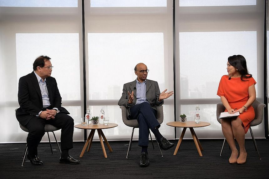 Senior Minister Tharman Shanmugaratnam at a fireside chat yesterday with OCBC Bank group chief executive Samuel Tsien (left) and moderator Yvonne Chan, where they discussed job matching and reskilling workers.