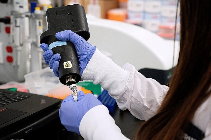 A scientist working on a vaccine for the coronavirus at a laboratory of Arcturus Therapeutics in California in March. There is currently only one Covid-19 vaccine candidate being tested here, the Lunar-CoV19 jointly developed by Duke-NUS and Arcturus