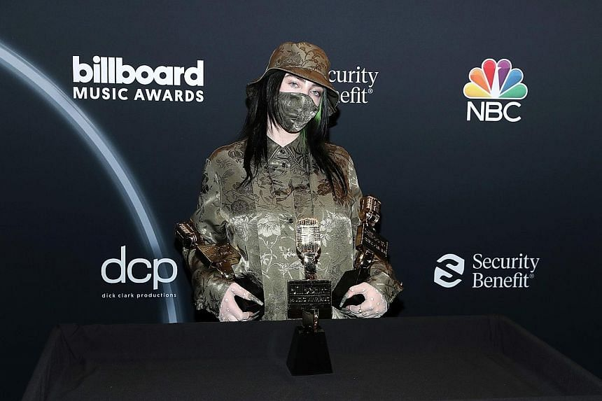American rapper Post Malone accepting awards on stage, and teenage singer Billie Eilish (above) with her awards.