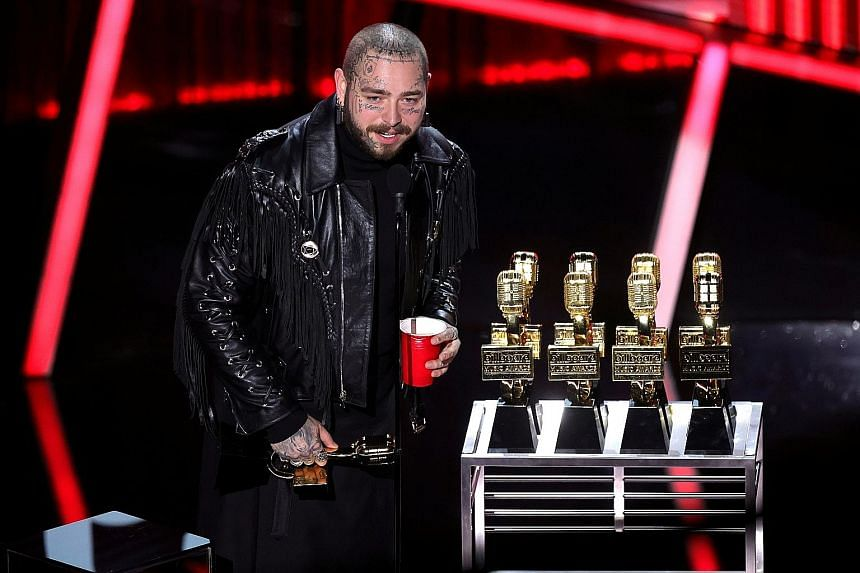 American rapper Post Malone (above) accepting awards on stage, and teenage singer Billie Eilish with her awards.