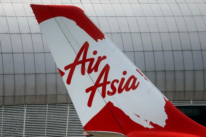 The airline plans to liquidate its small Indonesia-based carrier and has completely written down its stake in Thai AirAsia X in its books.