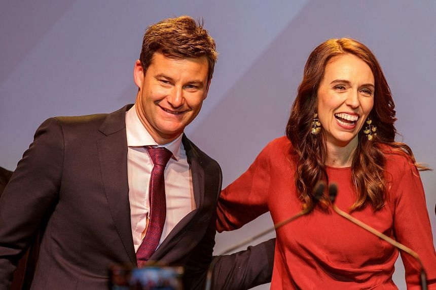 New Zealand Prime Minister Jacinda Ardern and her partner Clarke Gayford at the Labour Party's election night event in Auckland on Oct 17, 2020.