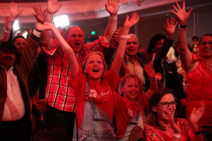 Labour supporters watching the results come for New Zealand's general election in Auckland on Oct 17, 2020.