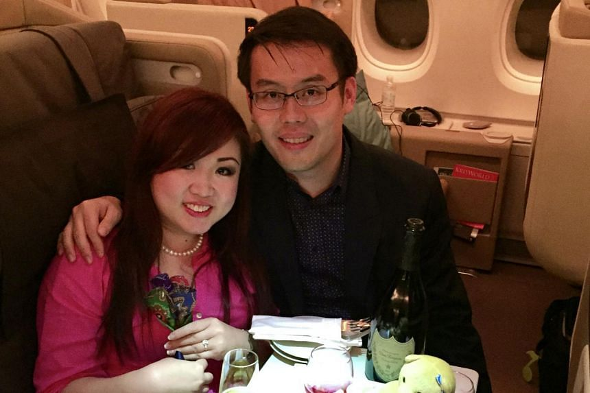 Ms Amy Tay and her husband Tan Si-Rong on an SIA flight to Australia in August 2015, where he proposed to her.