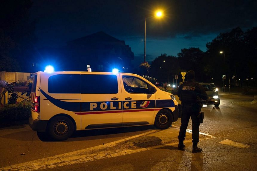 French police stand guard along a street near where a stabbing incident took place, in Paris, Oct 16, 2020.
