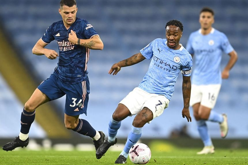 Manchester City's Raheem Sterling (right) in action against Arsenal's Granit Xhaka.