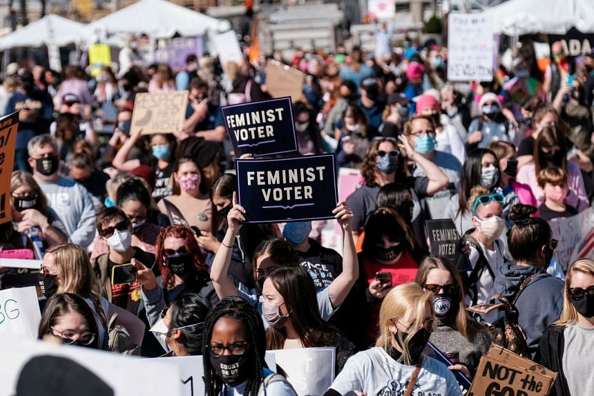 Women's March activists participate in a nationwide protest against US President Donald Trump in Washington, DC, on Oct 17, 2020.