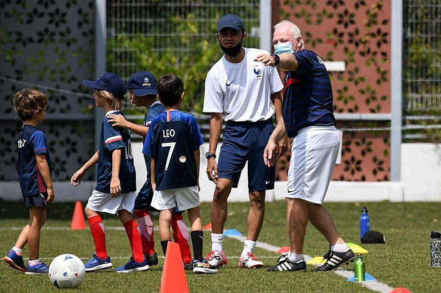 French Football Academy Singapore technical director Patrick Vallee gesturing during a training session at the Gems World Academy yesterday.
