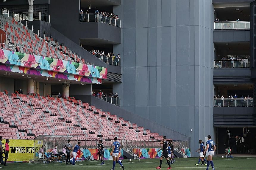 Hougang fans watching the match against Tampines Rovers from a vantage point outside the stadium yesterday and they mostly maintained 1m safe distancing. Covid-19 had forced the league to be suspended in March. A handful of fans watching the Singapor