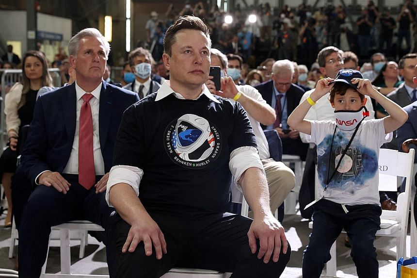 Mr Elon Musk at a briefing after the launch of a SpaceX rocket and spacecraft from Cape Canaveral in Florida in May. He is building prototypes of the Starship rocket in Texas to further his ambition of establishing a self-sustaining city on Mars.