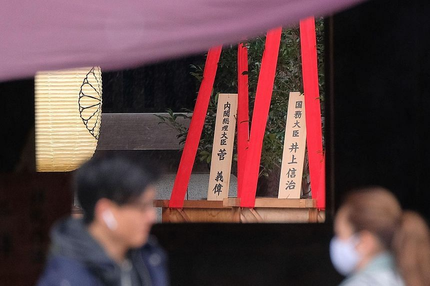 """A wooden plaque (background, left) bearing the name of Japanese Prime Minister Yoshihide Suga is seen with a """"masakaki"""" tree at the Yasukuni Shrine for war dead in Tokyo. Mr Suga, who became premier last month, sent the offering to coincide with the"""