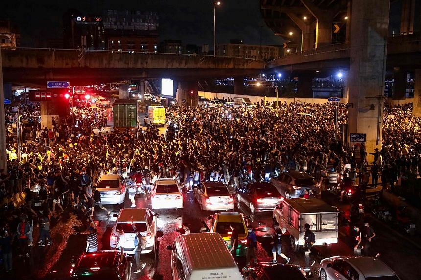 Protesters gathering during an anti-government rally in Bangkok's Udomsuk area yesterday. The flash mobs in the city ended peacefully after a few hours.