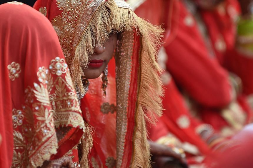 Indian Muslim brides participate in a mass marriage in Ahmedabad, India, on Dec 3, 2018.
