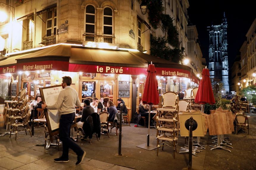 About 20 million people in the Paris region and eight other French cities were facing a 9pm-6am curfew from Oct 17.