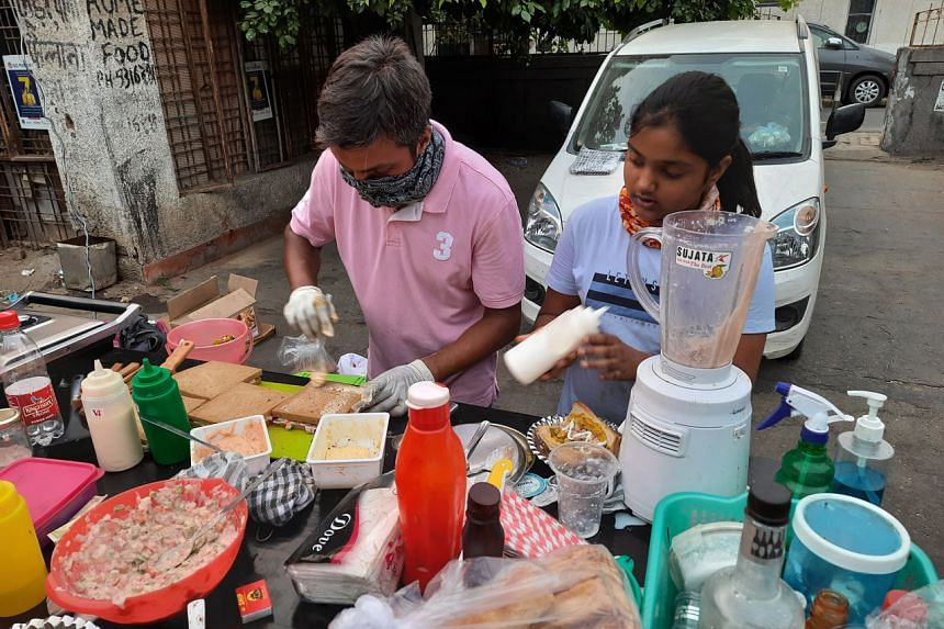 Mr Ravi Kant, assisted by his daughter Navya, sells mostly burgers, sandwiches and beverages at his stall.