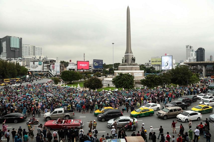Pro-democracy protesters gathering at the Victory Monument in Bangkok on Oct 18, 2020.