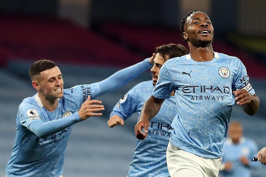 Manchester City forward Raheem Sterling celebrating his second goal in four Premier League matches with the winner against Arsenal on Saturday. Pep Guardiola's men have played one game fewer than most of their rivals as they were allowed to start the