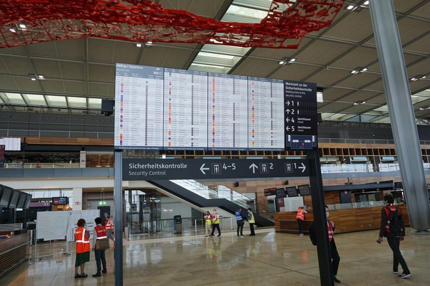 Airport staff are simulating regular operations at BER during its first test-run on July 30.