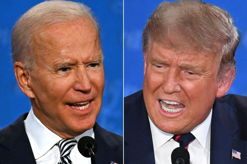 Democratic Presidential candidate and former US Vice President Joe Biden (L) and US President Donald Trump speak during the first presidential debate at the Case Western Reserve University and Cleveland Clinic in Cleveland, Ohio.