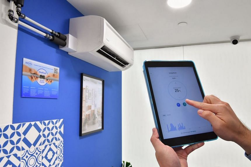 An app controls the temperature and the air-conditioning unit powered by a centralised cooling system at the MyTengah Experience Centre on Oct 19, 2020.