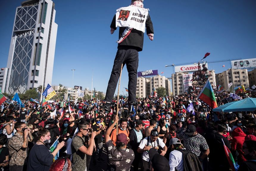 Demonstrators participate in a march at the Plaza Italia in Santiago, Chile, on Oct 18, 2020.