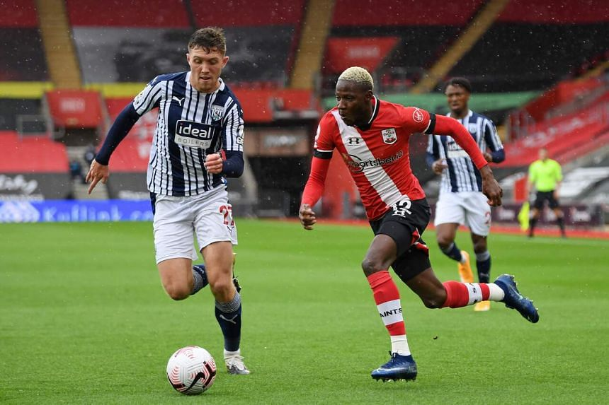 Southampton's Malian midfielder Moussa Djenepo runs with the ball as West Bromwich Albion's Irish defender Dara O'Shea chases back during the EPL football match on Oct 4.